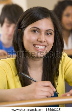 Female college student listening to a university lecture