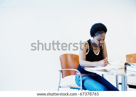 Female college student reading book