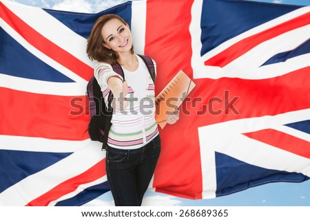 Female College Student Showing Thumb Up Sign Isolated Over White Background - stock photo