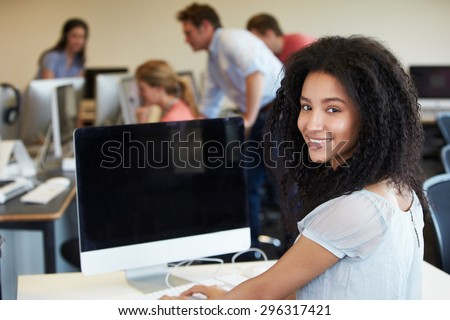 Female College Student Using Computer In Classroom - stock photo