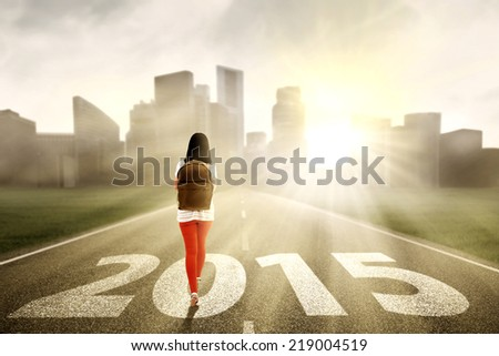 Female college student walking on the highway to get success in the future 2015 - stock photo