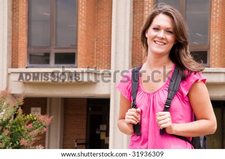 Female college student with backpack leaving admissions office at university. - stock photo