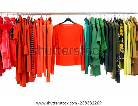 female colorful clothing hanging a on display  - stock photo