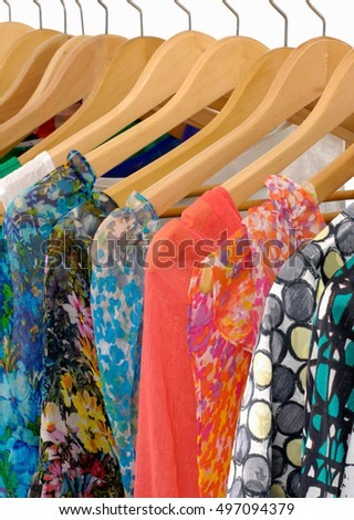 Female colorful summer clothes isolated on hanging