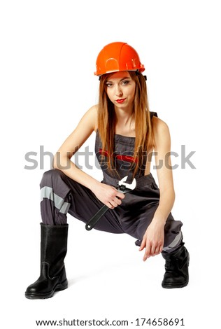 Female construction worker against a white background - stock photo