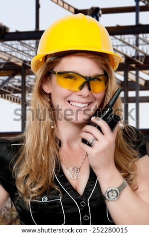 Female construction worker on a job site - stock photo