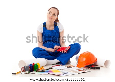 Female construction worker on a white background. - stock photo