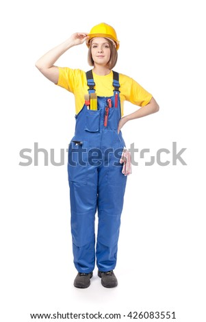 female construction worker or decorator in yellow hardhat and work wear isolated on white background