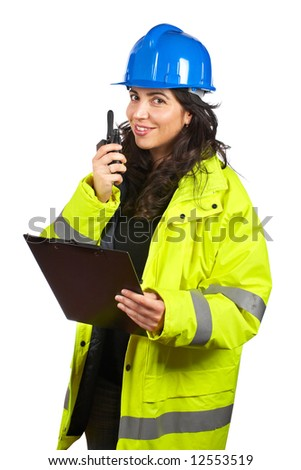 Female construction worker talking with a walkie talkie, over a white background