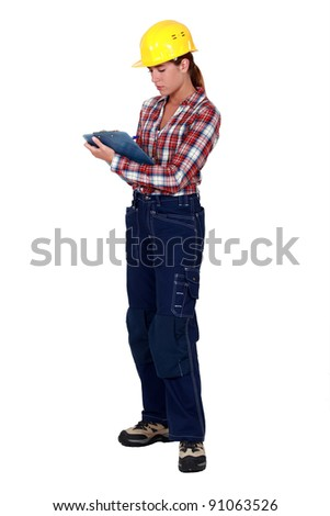Female construction worker with a clipboard - stock photo