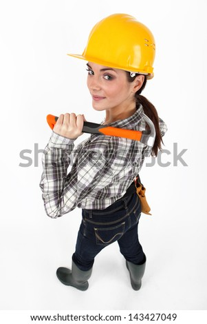 Female construction worker with a hammer - stock photo