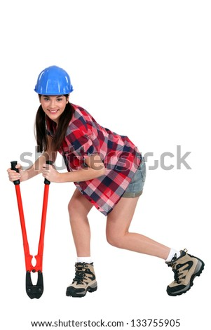 Female construction worker with boltcutters - stock photo