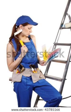 Female construction worker with palette in hands on a white background - stock photo