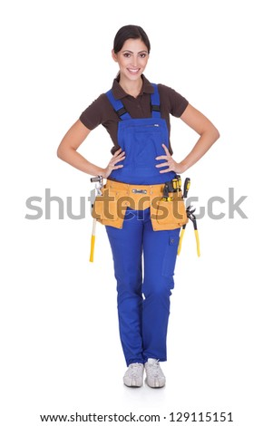 Female Construction Worker With Toolbelt. Isolated On White - stock photo