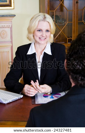 female consultant at work with her client - stock photo