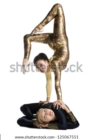 Female contortionist duo performing - stock photo