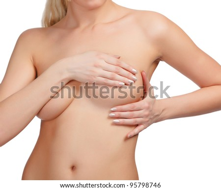Female controlling breast for cancer, isolated on white background
