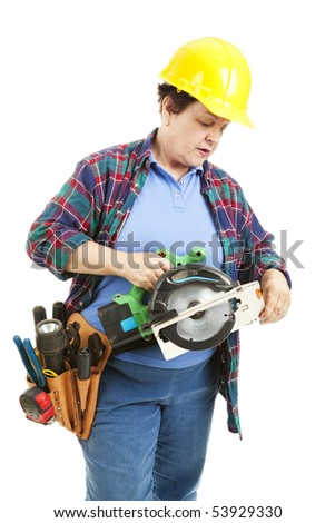Female contruction worker trying to figure out how to use a circular saw.