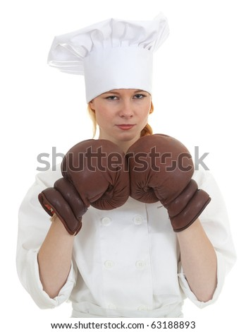 female cook in white uniform and boxing gloves - stock photo