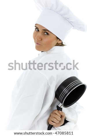 female cook in white uniform and hat keeping black pot for backs
