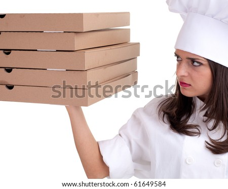 female cook in white uniform and hat with boxes of pizza