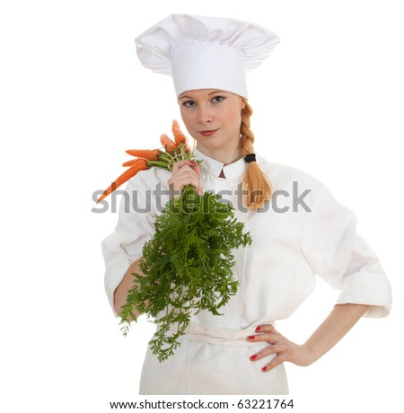 female cook in white uniform and hat with bunch of carrots - stock photo
