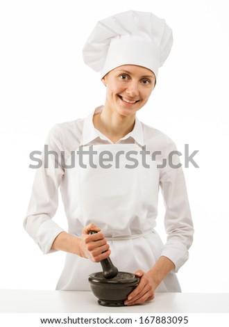 Female cook pounding something using mortar and pestle, closeup shot - stock photo