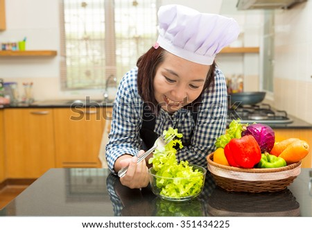 Female cook prepare vegetable to make salad