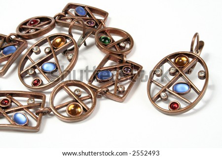 Female costume jewellery bracelet and ornaments on ears - stock photo