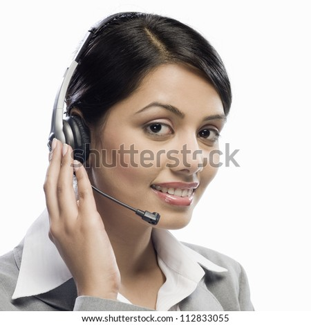 Female customer care executive wearing a headset against a white background - stock photo