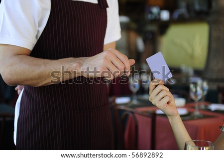 female customer paying with credit card at the restaurant