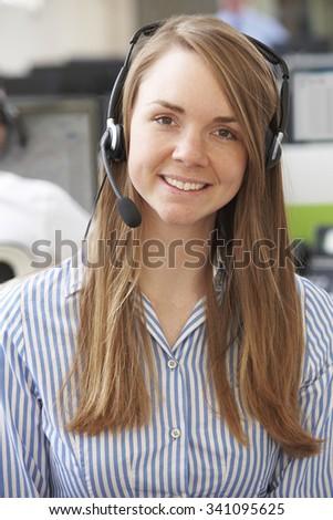 Female Customer Service Agent In Call Centre - stock photo