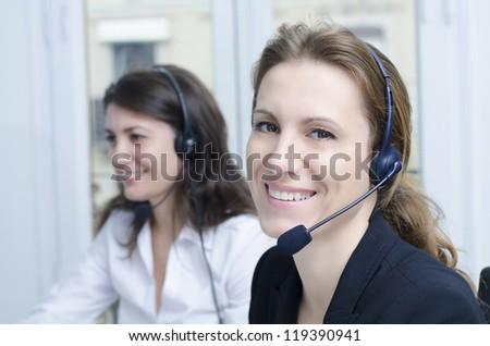 Female customer service representative at her desk - stock photo