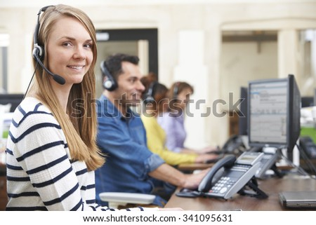 Female Customer Services Agent In Call Centre - stock photo