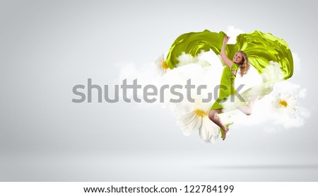 Female dancer and green heart symbol from fabrique - stock photo