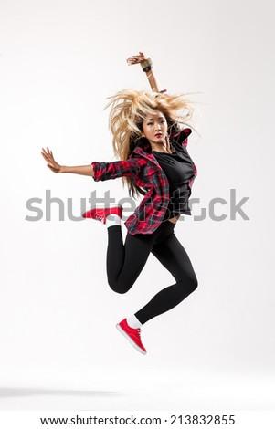 female dancer posing on studio background - stock photo