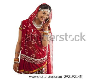 Female dandiya dancer talking on a mobile phone