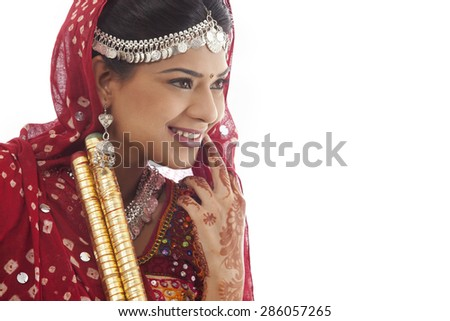 Female dandiya dancer with sticks