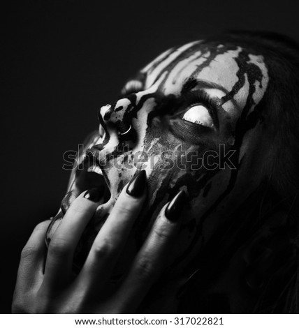 female demon.Art studio shot.Goth girl  - stock photo