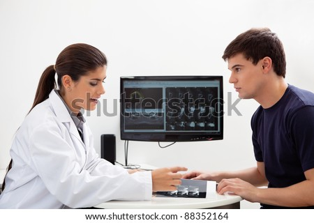 Female dentist discussing report with patient at clinic - stock photo