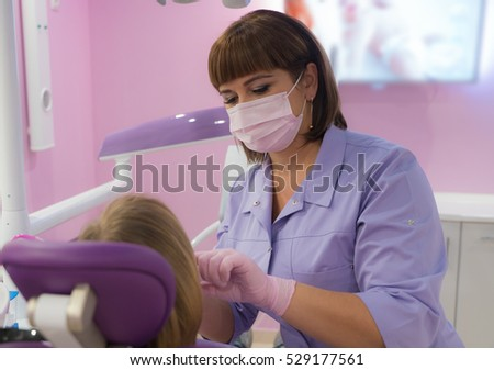 female dentists treating patient