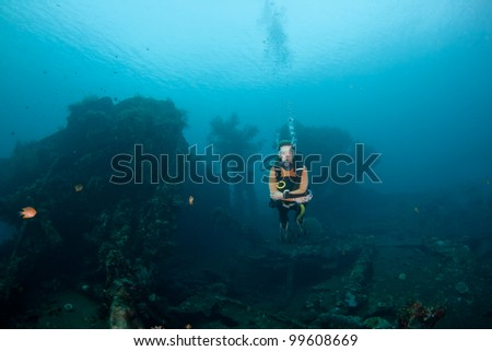 Female diver a the Liberty Wreck at Tulamben, Bali - stock photo