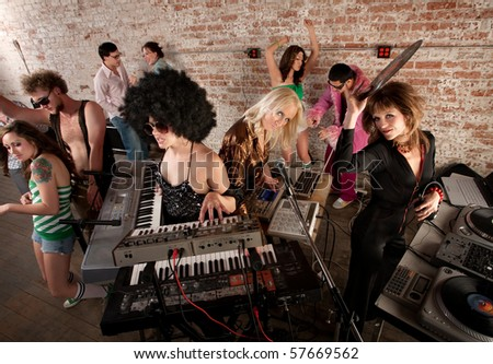 Female DJs Rocking a Disco Music Party - stock photo