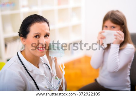 Female doctor and little girl patient.  Medical examination. - stock photo