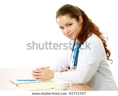 Female doctor at desk - isolated on white background