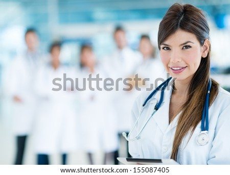 Female doctor at the hospital leading a medical team  - stock photo