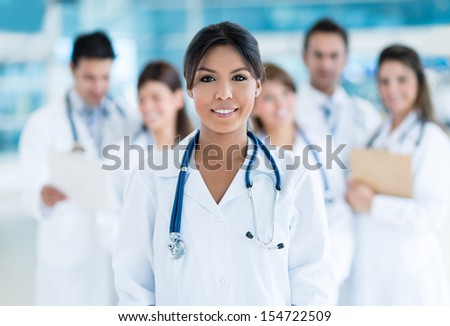 Female doctor at the hospital with her team