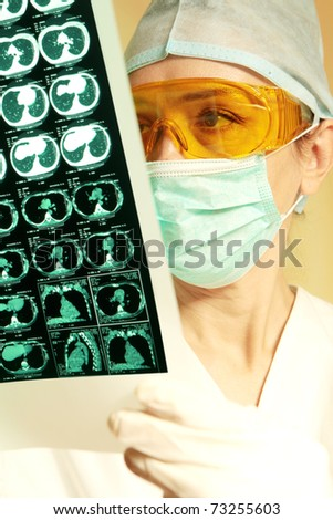 Female doctor checking an MR exposure - stock photo