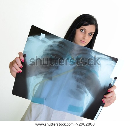 Female doctor checking xray image, isolated on white background.