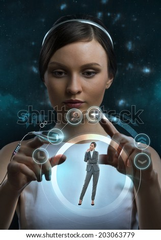 Female doctor doing checkup of human body using futuristic computer technology - stock photo